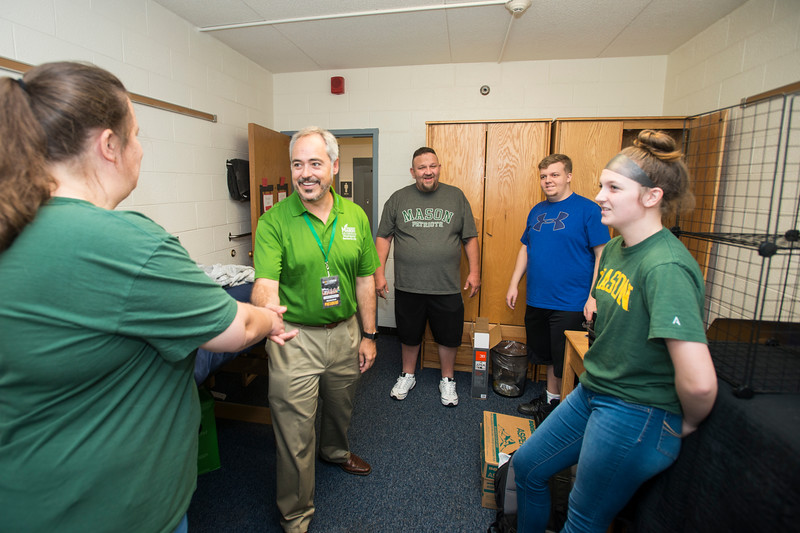 President Ángel Cabrera greets Freshman students and parents during Freshman move-in day at Fairfax campus.  Photo by:  Ron Aira/Creative Services/George Mason University