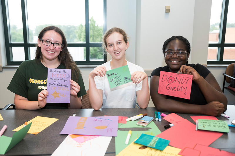 Students participate in Mason's 9/11 Day of Service by volunteering through service projects. In partnership with the local non-profit FACETS, students make cards to go in hygiene kits that will be given to people in need in our community. (Bethany Camp/Creative Services/George Mason University)