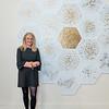 """1_DPL5792 Karen Tompkins in front of her painting """"Atomic Clock"""""""