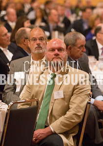 051514 RealEstate - The Commercial Real Estate Developers Power Breakfast was held at the Duke Energy Convention Center this morning. Tim Fuerbacher listens to keynote speaker Jeffrey Anderson, founder and CEO of Jeffrey R. Anderson Real Estate, Inc.  Photograph © Bruce Crippen