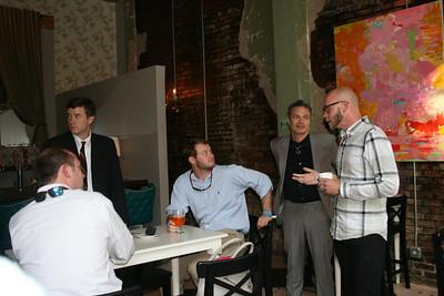 Casey Bollogorska and Alexandro Santana discuss art with the audience.