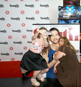 Heather Davis and Lori Gantt getting their selfie next to Adam Rodriguez.