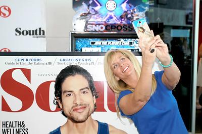 Rachel Cuf taking her selfie next to Adam Rodriguez for the Selfie contest.
