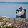 Snapping the flowers on the San Juan Island shoreline, on an SJPT-guided hike on protected property.