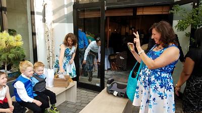 Stefani Timmons taking picture of Madeline, Milo, & Samson. Aryn Gittis in background.