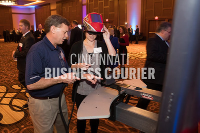 Jimmy Hyden of Ironworkers Local 44 shows Jessica Fitzwilson how to operate the VR welding demo