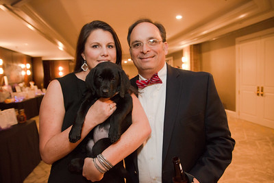 Priscilla and her husband Roger Cowart with the donated puppy