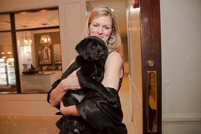 Kelley Waldron with the auction Labrador puppy