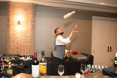 Nico Williams, bartender showing off his bottle skills