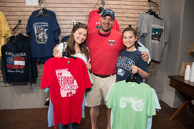 Anna Grace, Bobby and Ava Sapp show off their t-shirt purchases.