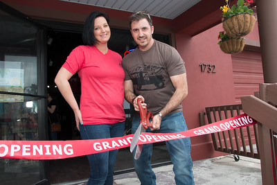 Sarah and Danny Merritt cut the ribbon on their new store.