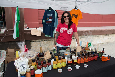 Valerie Langenburg shows off some of the sauces, ciders and shirts on sale.