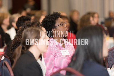 Aurora Oluyemi of Dress for Success Cincinnati listens to the keynote address