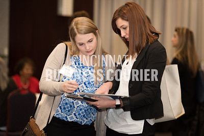 Kaylie Ferrara of Now Worldpay looking through the list of mentors with Laura Wasson of Clippard Instrument Laboratory Inc.