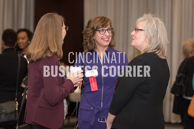 Brigid Cucinotta of Xavier University (sponsor) talks with friends
