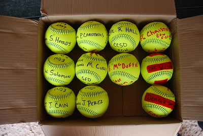 Signed Baseballs with each of the participating team players name.