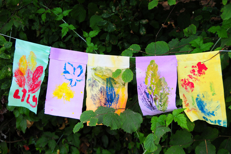Prayer flags created at the festival with plant and leaf prints.