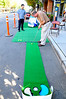 They were clever and set up a putting green, so they could have fun, practice their golf, and host a site at the same time.