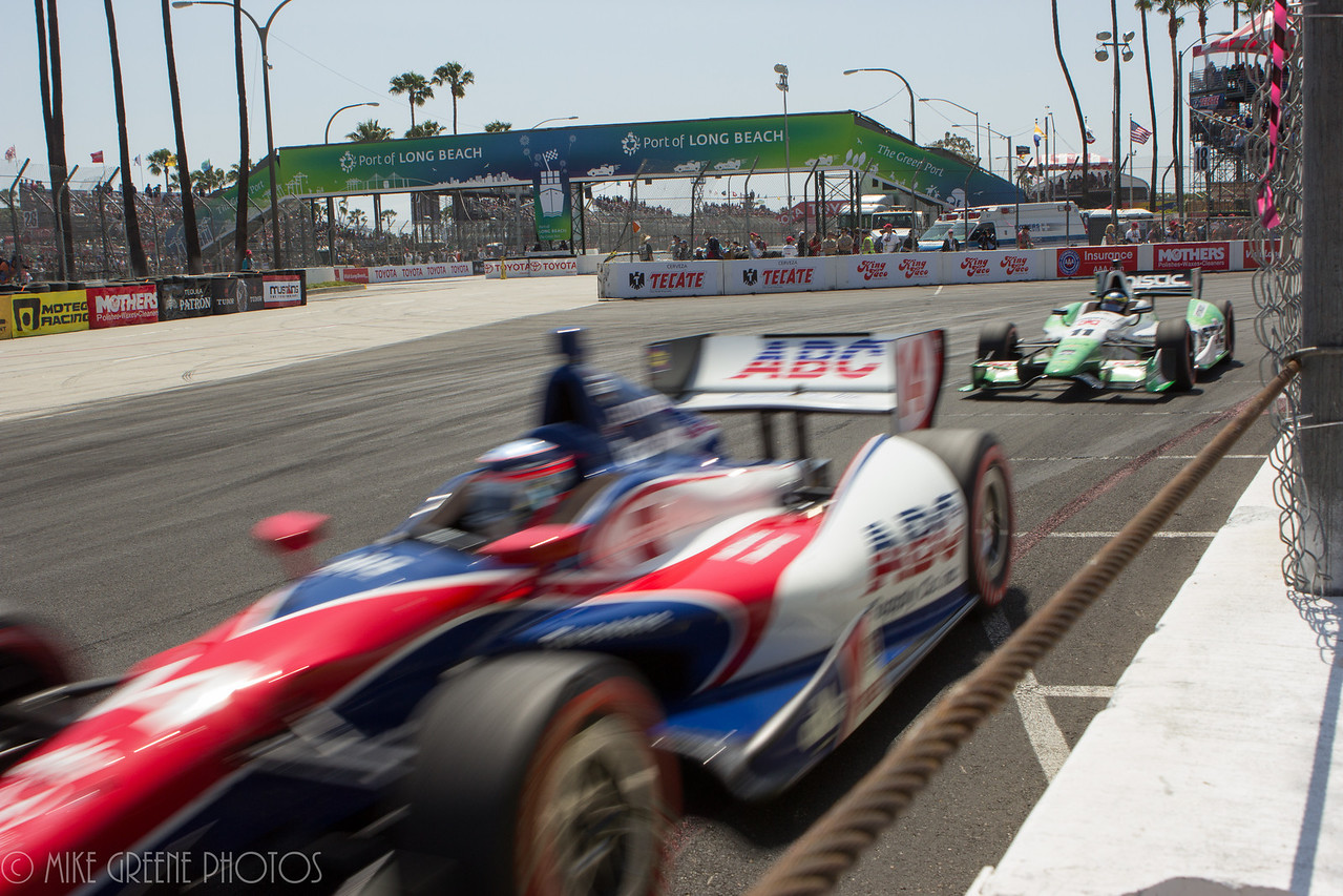 Cars charge throug turn 10 near the  start of the 2014 Toyota Grand Prix of Long Beach Indycar race