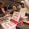 Susann Miller chats with a customer at the LA Lit and Toy Show.  Photo by Mike Greene.