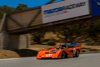 Chris Bender of Reno, Nevada powers toward turn 9 in his 1972 McLaren M8FP during the Saturday qualifying race. (Photographer:  Mike Greene)