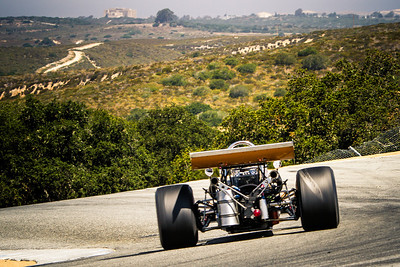 The 1969 McLaren M10A owned by Martin Fogel Jr, apexes at the top of the corkscrew.  (Photographer:  Mike Greene)