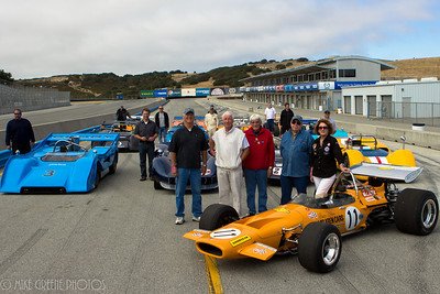 Family photo:  McLaren family members and associates gather around some of Bruce McLaren's iconic racing cars