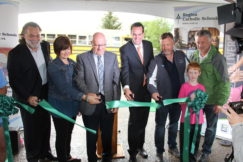(L to R) Max Bouchard, Regional Sales Manager, Blue Bird; Carla Beck, MLA Regina Lakeview; Domenic Scuglia, RCSD Director of Education; Erin Weir, MP Regina Wascana; Ward Hepting, President, Legacy Bus Sales;  David White, Vice President of Operations, LP3 Transportation Solutions; Ecole St. Mary student.
