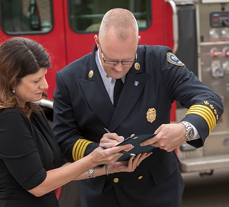 Fire Chief, David Pennington, signs the oath of office he just took during the swearing in ceremony.