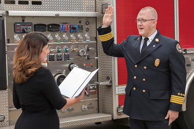 City Clerk, Anita Cotter, administers the oath of office to newly-appointed Fire Chief David Pennington.