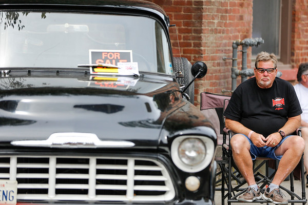 "Kenny Hoerter Sr. sits by his car at the Beatersville Car and Bike show. Hoerter owns a shop in Butchertown where he keeps his pristine hotrods and memorabilia from as early as the 1940's. ""I just like lookin' in the past I guess."""