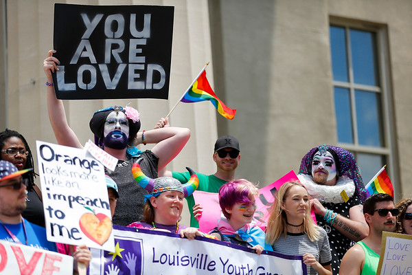 Many of those who attended the LGBTQ Equality Rally for Unity and Pride brought signs and banners and were invided to stand up front on the steps outside of Louisville Metro Hall.