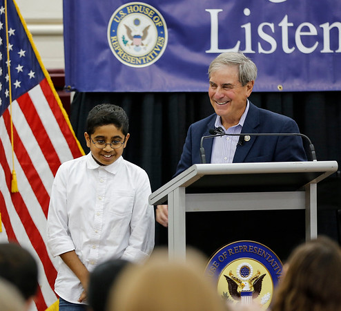 "Eleven year old Pavan Venkatakrishnan walks off the stage after speaking at the podium during the Q&A portion of the Town Hall.  Venkatakrishnan applauds the ACA, and states that it is ""an amazing bill with so many provisions that help so many people"", but he asks ""Why didn't Democrats do a better job of marketing the bill?"""