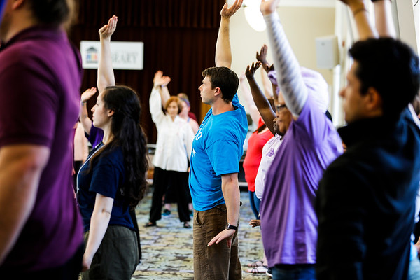 Festival goers practice their Tai Chi while attending one of the many programs at the Louisville Free Public Library's How-To Fest.