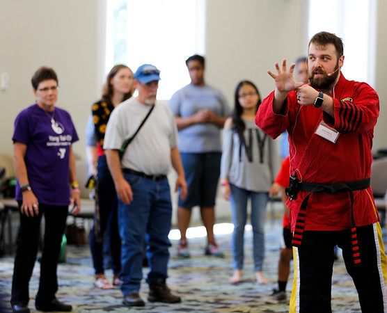 Alan White (right) of St. Matthews Martial Arts demonstrates how to defend against attackers.