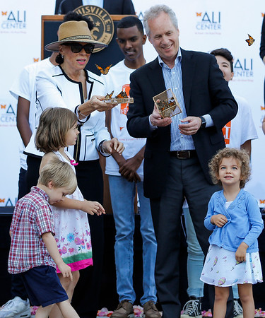 Lonnie Ali (left) and Mayor Greg Fischer (right) symbolically release butterflies at the end celebration.