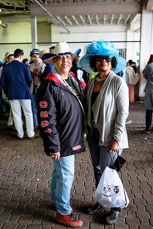 "Pat Jackson (left) and Toni Jones (right) traveled from Kansas City, Missouri for the Kentucky Derby. ""We came for the horses, because we ride horses ourselves"" said Jackson. Both women are members of the non-profit Twin City Saddle Club where they mentor young men and women in the community through non-traditional activites."