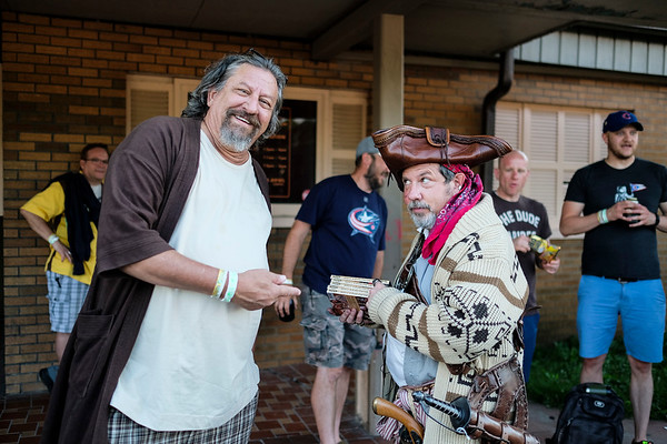 John Kovarik (left) and Brian Scoop Diehl (right) pose for a photo while waiting in line to enter Executive Strike and Spare for the 16th Annual Lebowski Fest.