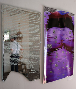 """Tobias Cameran Stalder is seen in the reflection of his piece titled """"The Boy in the Mirror, the Girl in the Reflection""""."""