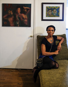"Jasmine Smith sits below her two pieces titled ""No Evil"" (left) and ""Bantu Knot"" (right) at the opening reception of the Queer Voices 2017 art exhibition.  ""After Photographing drag shows and portraits of trans and non binary friends, I have compiled many images of raw individuality. I plan on creating portraits in fantastical worlds while enhancing the figures' gender expression."""