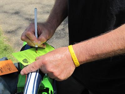 Biker filling out a Bike Valet Ticket