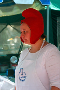 The Phrygian cap was adopted by freed slaves in Roman times, and thus this cap became a symbol of liberty. This headgear made its last appearance in the 18th century during the French Revolution. http://en.wikipedia.org/wiki/Phrygian_cap This lady is serving escargots.
