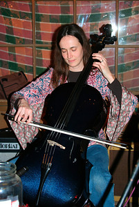 Jill playing on her new carbon fiber blue cello