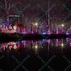 Some of the St. Louis Zoo wildlight displays reflect in one of the many water locations located in the St. Louis Zoo.  The display is held during the Christmas Season allowing visitors a chance to enjoy the park decorated in animal themed lights.