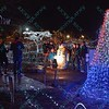 To celebrate the season a family stops and takes a picture with one of the displays that the St. Louis Zoo uses to light up different areas of the zoo giving visitors a chance to enjoy wonderful lighted displays with an animal theme.