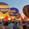 Crowds gather and get up close to the Beemster and US Bank Hot air balloons, along with others light up the night sky in the popular event held at Forest Park in St. Louis, MO on 9/19/14
