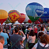 Crowds gather to watch the Beemster and US Bank Hot air balloons, along with others light up the night sky in the popular event held at Forest Park in St. Louis, MO on 9/19/14