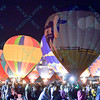 Hot air balloons light up the night sky in front of a large crowd during the popular event held at Forest Park in St. Louis, MO on 9/19/14