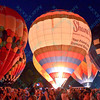 The Shane Company hot air balloon lights up the night sky in front of a large crowd during the popular event held at Forest Park in St. Louis, MO on 9/19/14