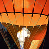 Flames fly high in a hot air balloon as it lights up the night sky in the popular event held at Forest Park in St. Louis, MO on 9/19/14